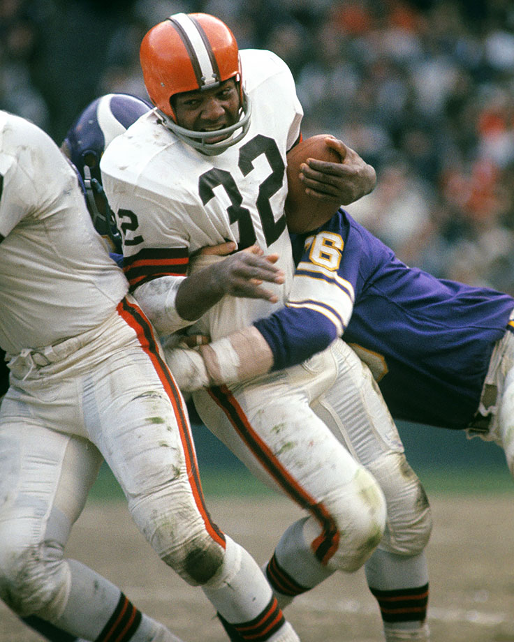 Jim Brown gets wrapped up on a carry against the Minnesota Vikings at Cleveland Municipal Stadium in 1965. His 39 yards were his second lowest total of the season.