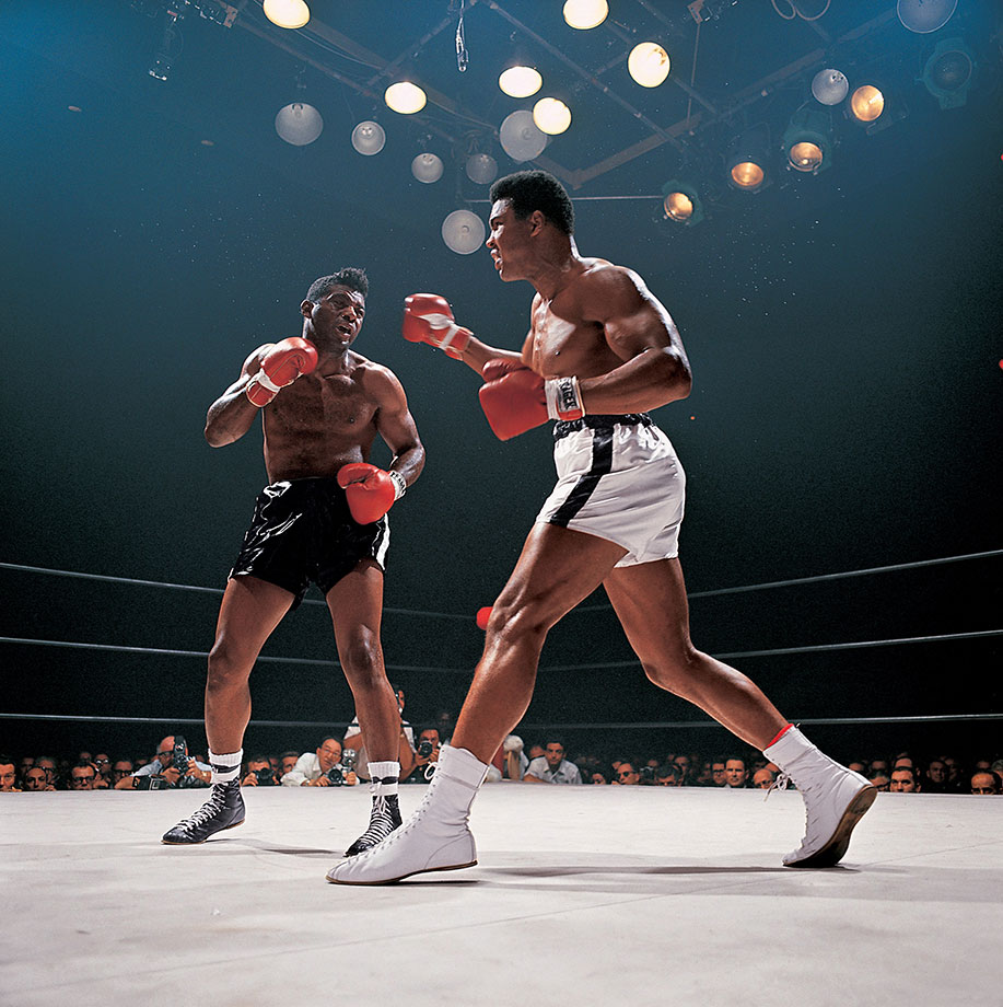 "In cruelly efficient performance, Ali punished Patterson — who was hobbled by a painful back injury — seemingly toying with the former champ throughout the bout, hitting him at will and calling, ""What's my name?"" before finally winning on a 12th-round TKO."
