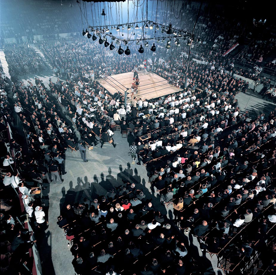 The first Ali Liston rematch was held in a hockey rink in Lewiston, Maine, and Leifer set up a remote camera in a corner of the arena.  This one of a kind photo captures the entire stadium during the fight.