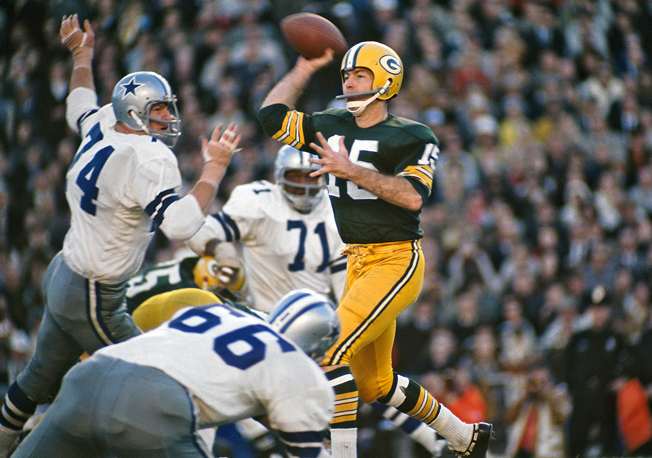 "Ever wonder what NFL life would be like with the ""Landry Trophy"" instead of the Lombardi Trophy? Before the Ice Bowl, the Cowboys could have won this one. The Packers went up 14-0 at the Cotton Bowl. The upstart Cowboys closed to within 21-20 later. The Packers stretched it out again to 34-20. But with Dallas within 34-27, Don Meredith carried his team to a first-and-goal at the Packers' 2-yard-line. Before long it was fourth-and-goal at the two. Then the Pack's Tom Brown intercepted a pass in the end zone."