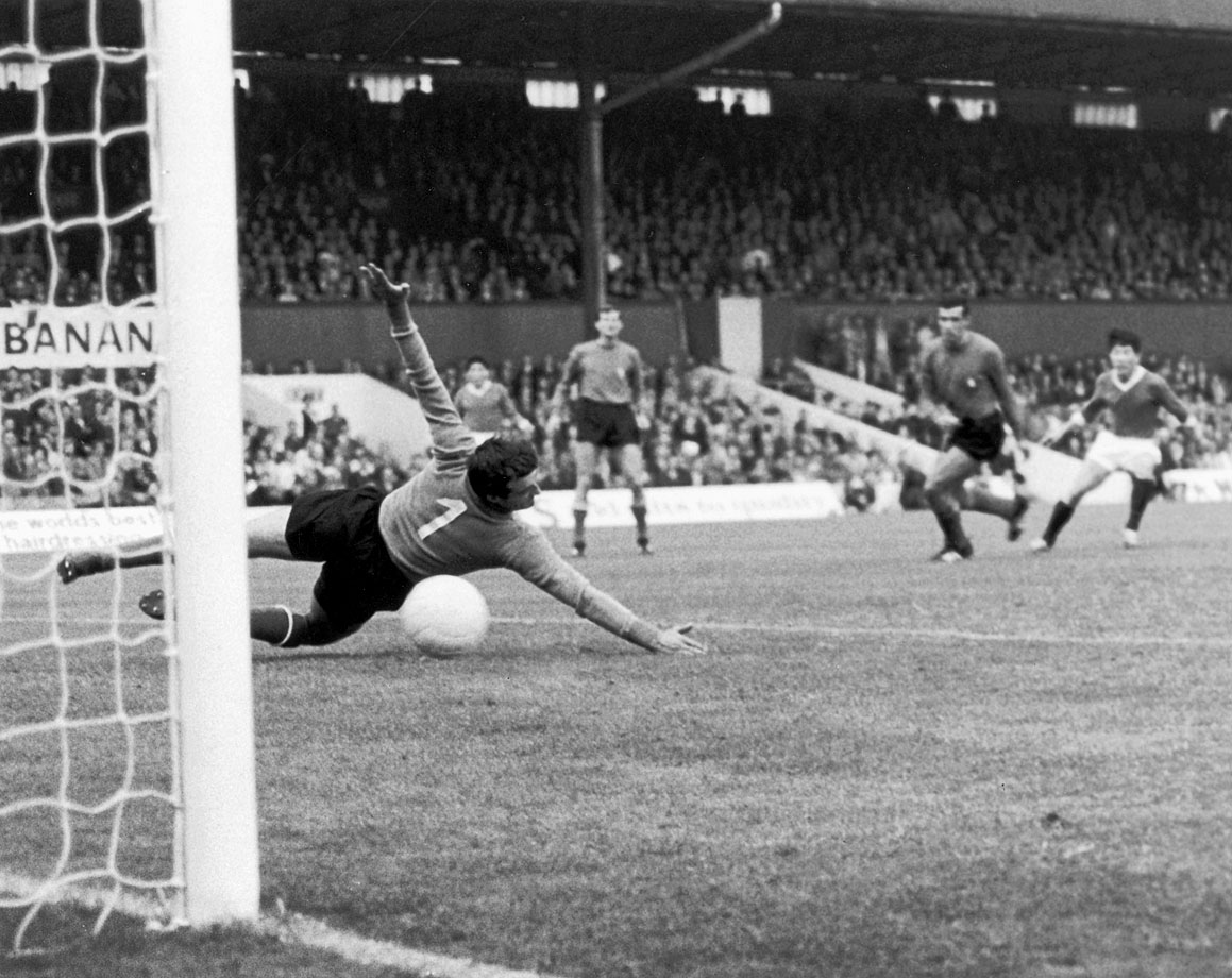 North Korean Pak Doo Ik celebrates after scoring against Italy's Enrico Albertosi, which ultimately was the lone goal in North Korea's 1-0 victory for the reclusive nation over Italy in the 1966 World Cup.