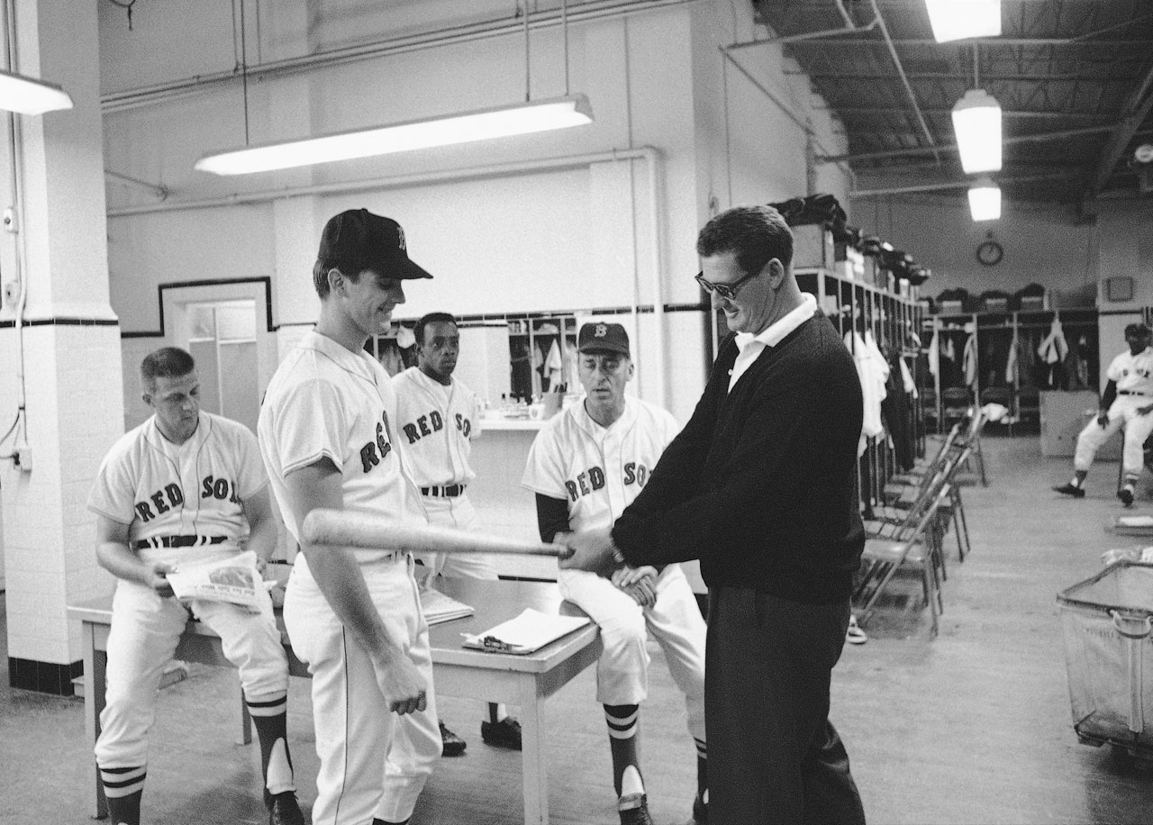 Ted Williams, now Red Sox Vice President, offers hitting tips to Tony Conigliaro before a game in 1966.
