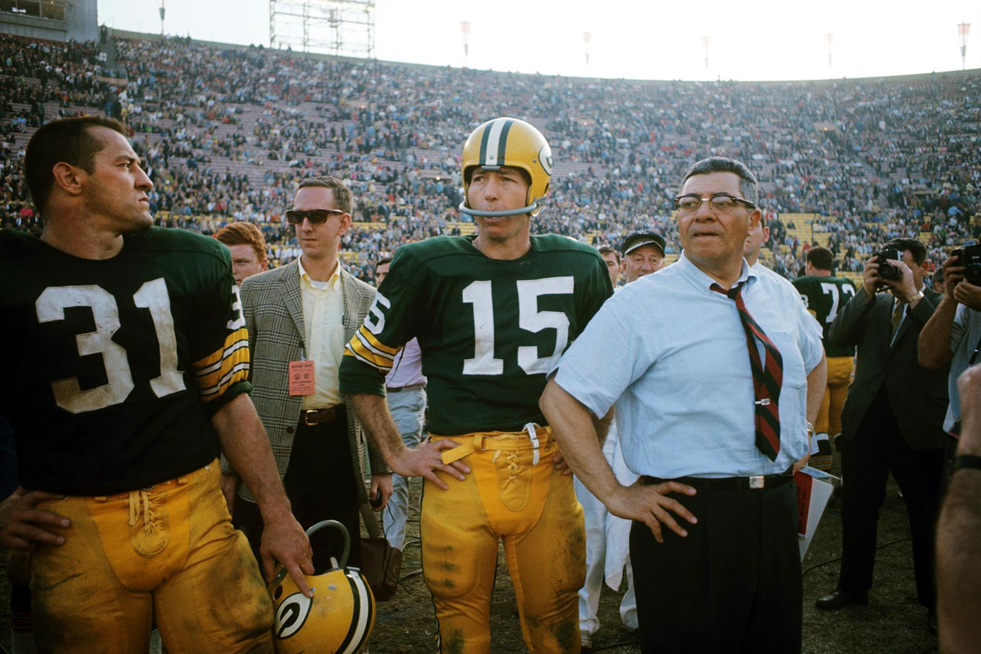 Bart Starr and Vince Lombard look on as the Green Bay Packers defeat the Kansas City Chiefs 35-10. After a close first half, the Packers scored 21 consecutive points to run away with the game.