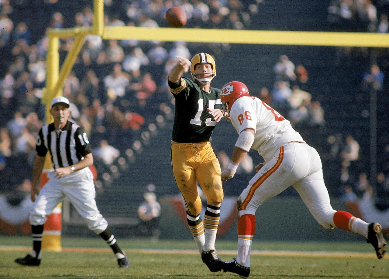 Green Bay Packers quarterback Bart Starr lofts a pass in the first meeting of AFL and NFL champions. Starr's 250 yards passing and two touchdowns earned him Super Bowl MVP honors.