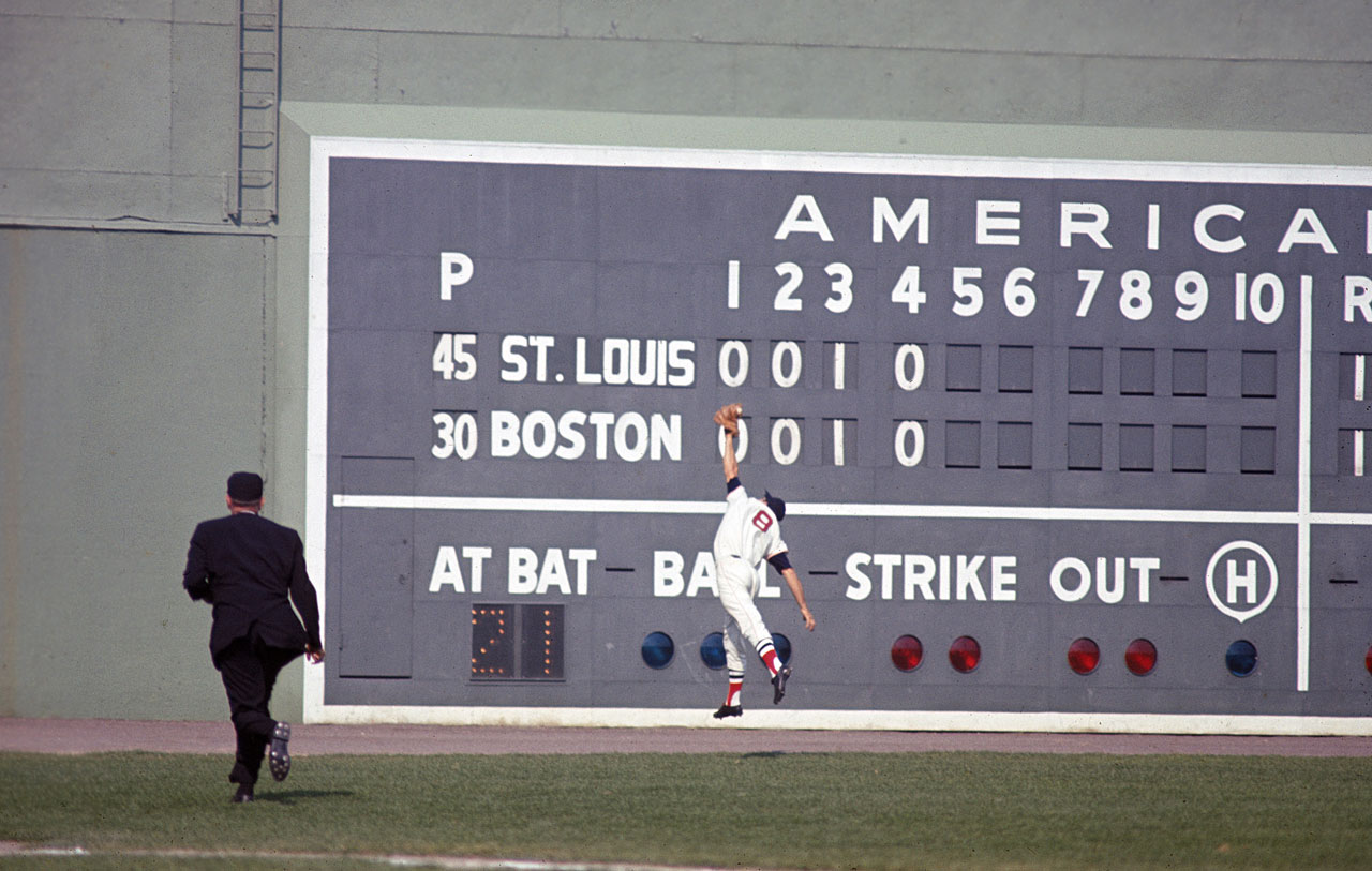 Carl Yastrzemski catches a ball hit by the St. Louis Cardinals' Curt Flood during Game 1 of the World Series on Oct. 4, 1967 at Fenway Park in Boston.