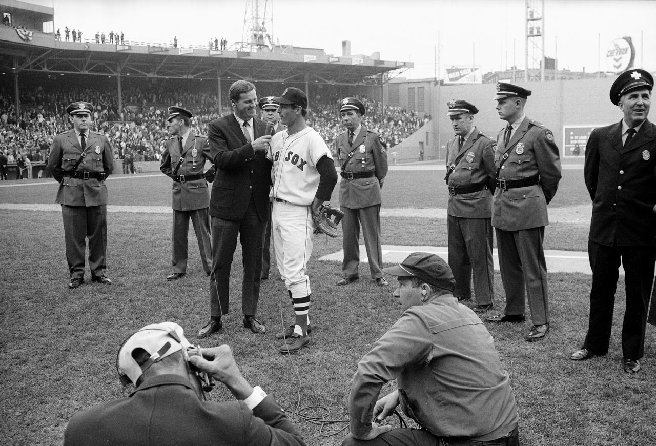 Carl Yastrzemski gives a media interview before Game 7 of the World Series on Oct. 12, 1967 at Fenway Park in Boston.
