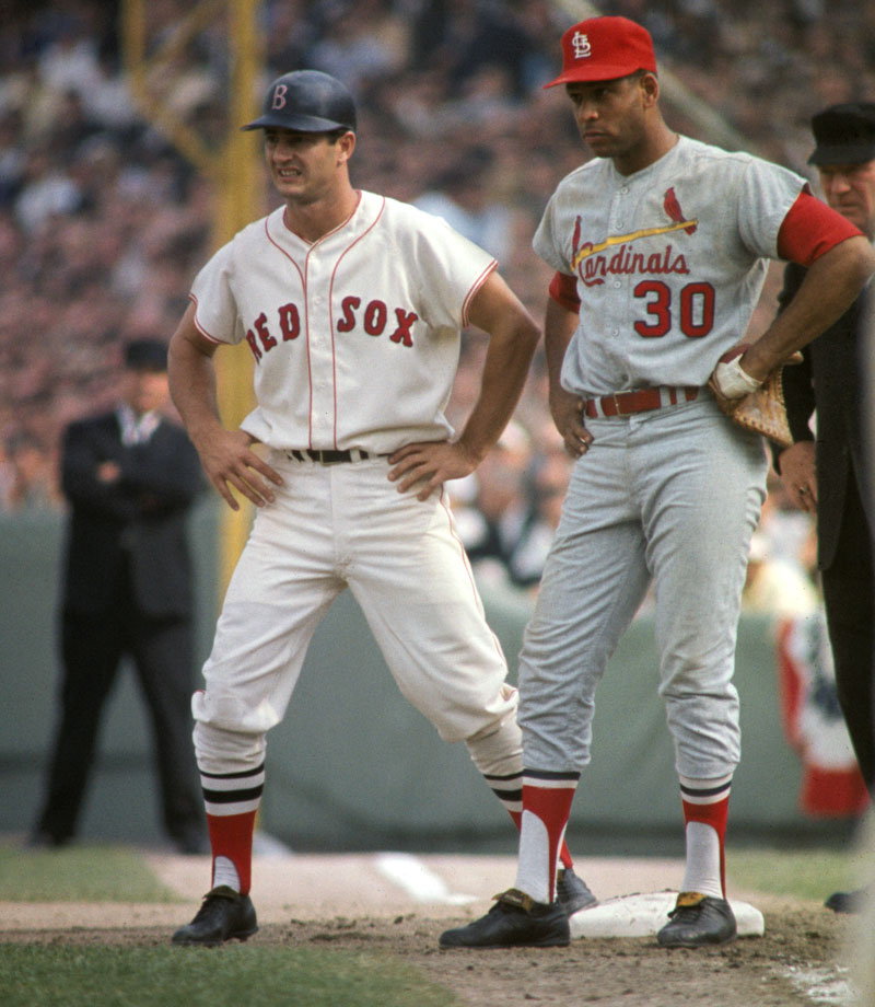 Carl Yastrzemski stands on first base as St. Louis Cardinals first baseman Orlando Cepeda looks on during Game 1 of the World Series on Oct. 4, 1967 at Fenway Park in Boston.