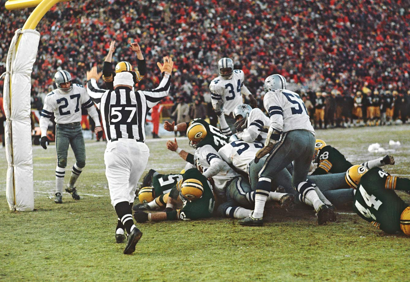 "It was minus-15 degrees at kickoff, with the wind chill at Lambeau Field averaging minus-45. Frozen tundra, indeed. With 16 seconds left and Green Bay at the Dallas 1, trailing by three points, quarterback Bart Starr tucked the football -- which, he said, felt like ""a piece of ice"" -- under his arm, followed a block by right guard Jerry Kramer, and snuck into the end zone to win what would be remembered as ""The Ice Bowl."""