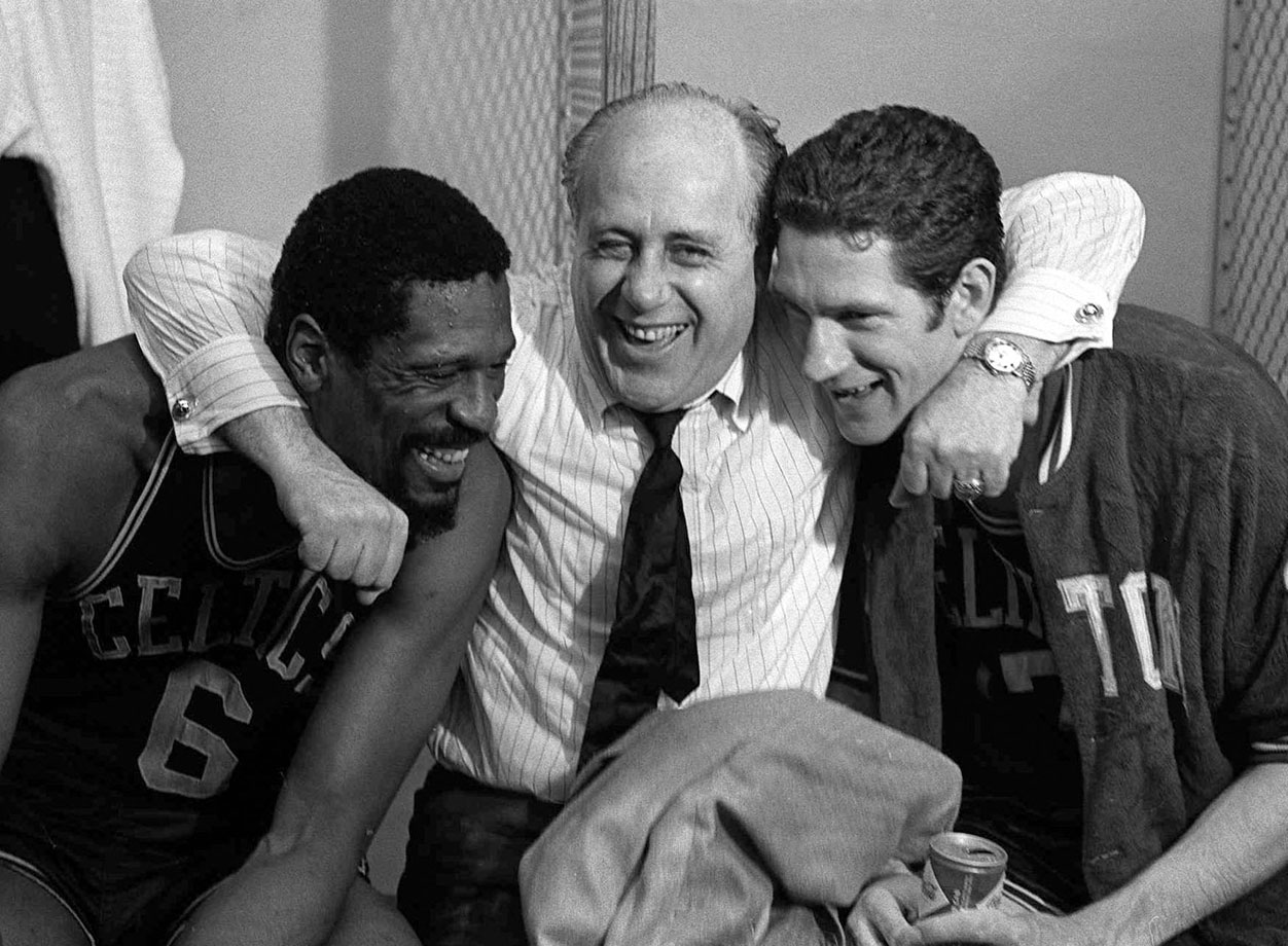 The stress of the 1967-68 season wore on Bill Russell, then serving as player-coach. The assassination of Martin Luther King, Jr. on April 4, a month before this photo was taken, is said to have weighed on Russell, too. But the Hall of Famer flashed a smile alongside longtime coach Red Auerbach and teammate John Havlicek after the Celtics beat the Lakers for the NBA title, ending a tumultuous year.