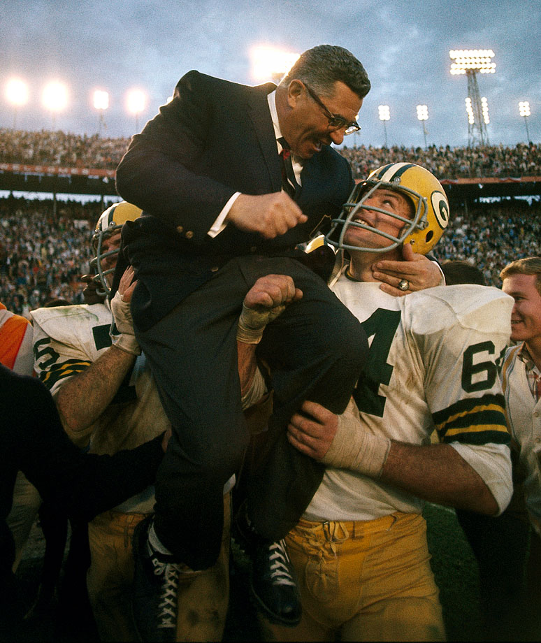 Jerry Kramer (64) and Forrest Gregg carry Vince Lombardi off the field after Green Bays' second straight Super Bowl triumph and Lombardi's final game as the Packers' coach.