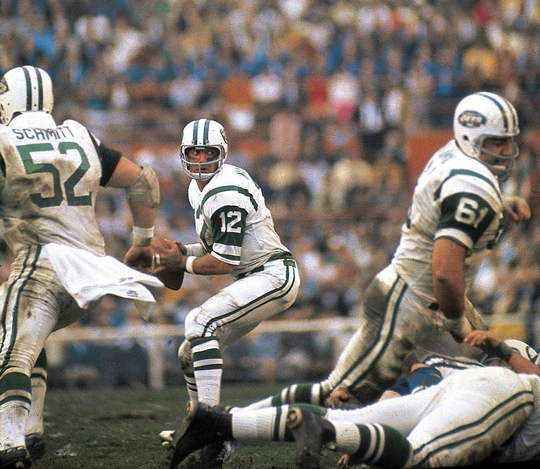 New York Jets quarterback Joe Namath looks to pass against the Baltimore Colts in SB III. Broadway Joe's team backed up his victory guarantee as New York upset the heavily favored Colts 16-7. Namath completed 17 of 28 passes for 206 yards and was named Super Bowl MVP.