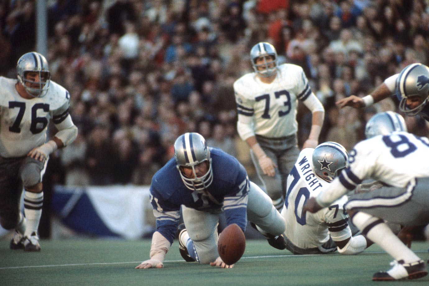 Alex Karras recovers a fumble during the NFC Divisional Playoff game between the Detroit Lions and the Dallas Cowboys on Dec. 26, 1970 at the Cotton Bowl in Dallas.