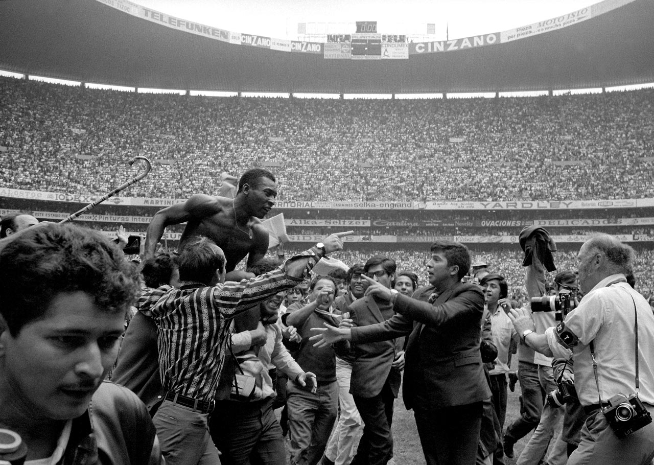 A shirtless Pelé is hoisted off the pitch after the 1970 World Cup final. It was a return to form for him, as he missed parts of the 1962 and 1966 tournaments due to injury.