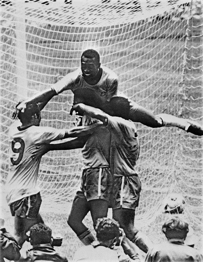 Pelé and Jairzinho celebrate after Pelé's goal in the 1970 World Cup final.