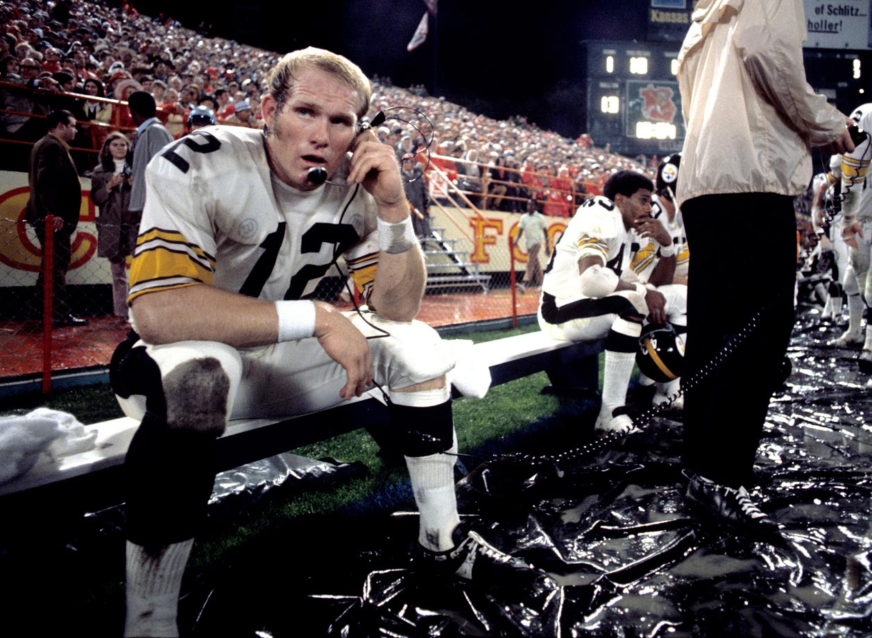 Terry Bradshaw takes a call from the bench during a rough loss to the Chiefs, 38-16, in 1971.