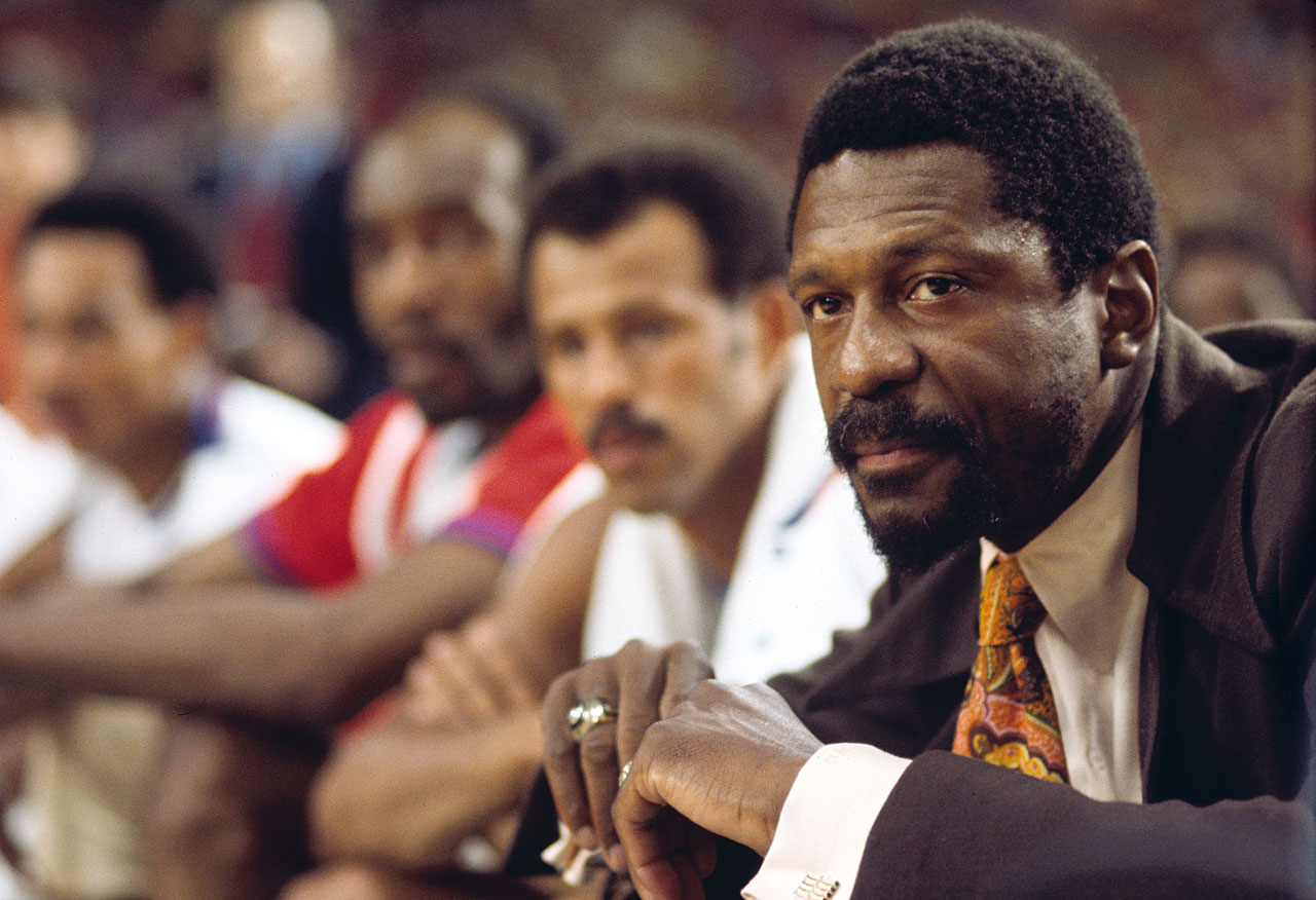Celtics head coach Bill Russell looks on from the bench during a game against the ABA All-Stars at the Astrodome in Houston.