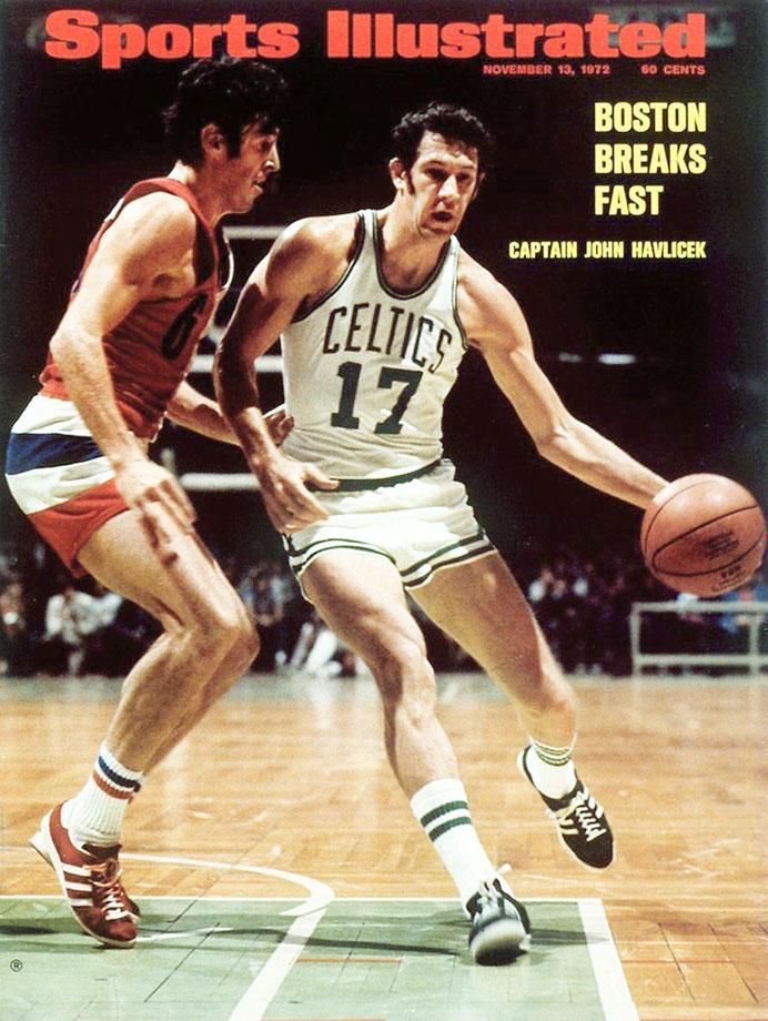 John Havlicek drives to the basket against Mike Riordan during a Celtics game against the Baltimore Bullets at Boston Garden.