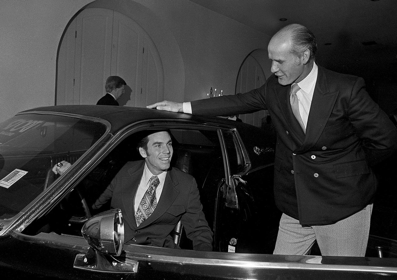 Dallas Cowboys quarterback Roger Staubach shows coach Tom Landry the sports model car he won as the most valuable player in the Super Bowl in New Orleans on Jan. 17, 1972.