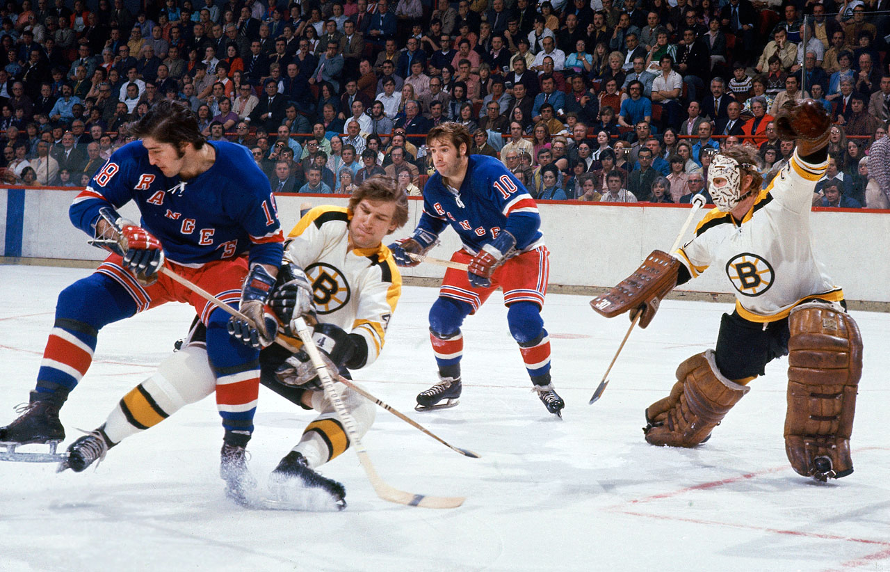 Walt Tkaczuk and the New York Rangers offered Boston a better fight than the Blues did in 1970, but Bobby Orr (center) in his prime was still too much to handle. The Bruins defenseman scored four goals in the final, including the winner in Game 6, and claimed the Conn Smythe Trophy as Boston, with goalie Gerry Cheevers and his iconic mask in net, bagged its second Cup in three seasons.