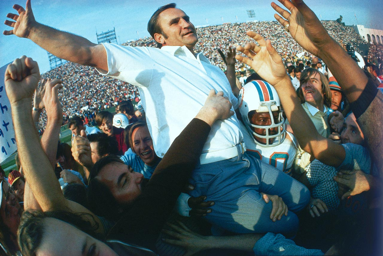 The Miami Dolphins carry head coach Don Shula off the field after defeating the Washington Redskins 14-7. The win capped off the Dolphins' undefeated season, still unmatched in NFL history, and gave Shula his first Super Bowl victory after losing Super Bowls III and VI.