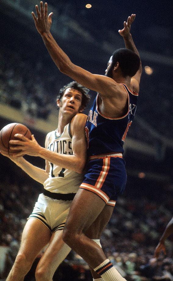 John Havlicek drives to the basket against Walt Frazier during a Celtics game against the New York Knicks at Boston Garden.