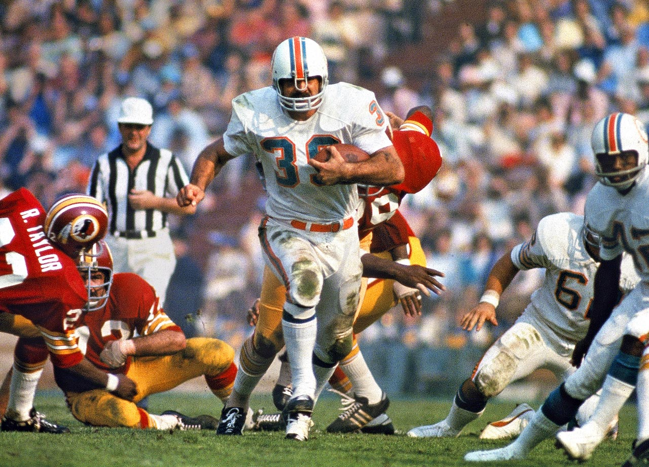 Miami Dolphins fullback Larry Csonka charges up the middle against the Washington Redskins. Csonka tallied 112 yards rushing on 15 carries to lead all rushers and spark Miami's 14-7 triumph.