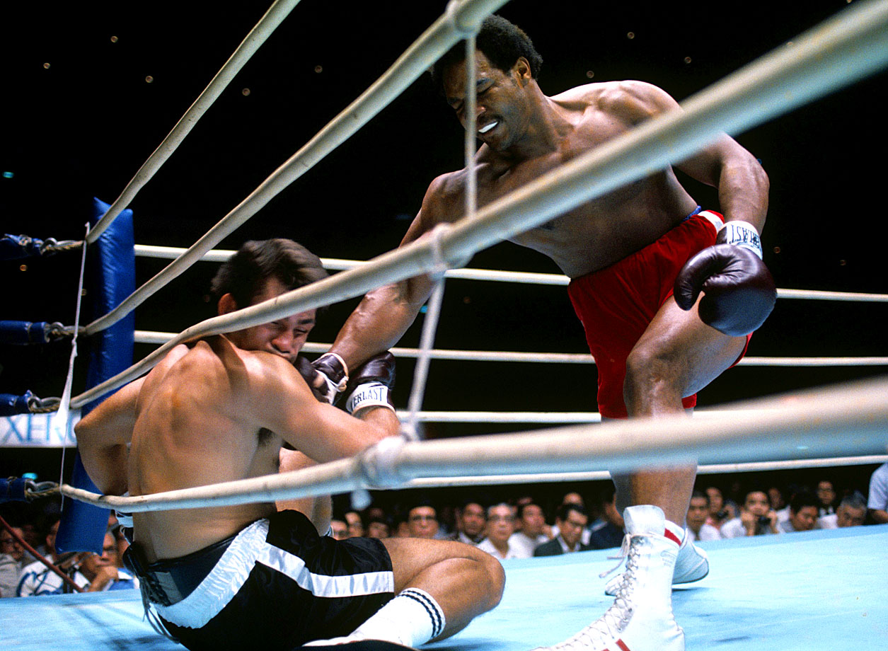 Big George at his bruising best: In his first defense of the heavyweight title, Foreman blasted the hapless Roman to the canvas three times in the opening round of their bout in Tokyo. The fight was over after just two minutes, and Foreman's reputation as a destroyer grew.
