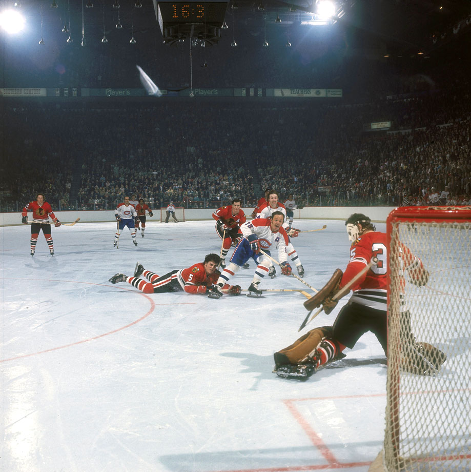 Chicago keeper Tony Esposito got the best of Montreal forward Yvan Cournoyer in this Game 1 sequence, but the Habs and the Roadrunner had the last laugh, winning 6-3. In all, Conn Smythe-winner Cournoyer tallied six times, including the clincher in Game 6, and produced 12 points to pace the Canadiens in a high-scoring series that saw the two teams combine for 56 goals.