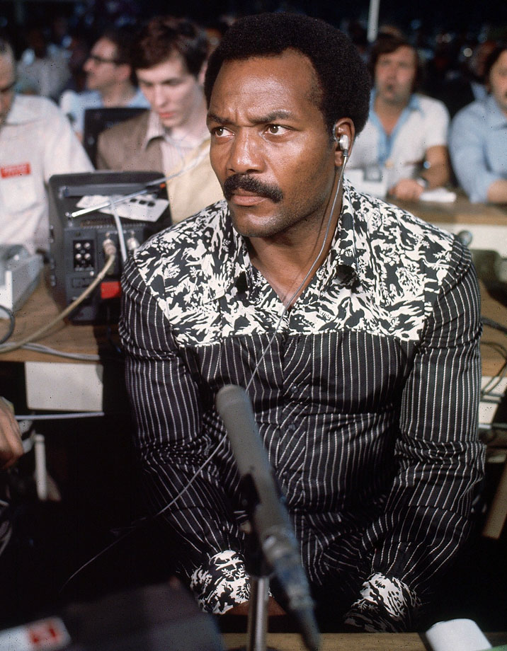 Jim Brown sits in the audience in Kinshasa, Democratic Republic of the Congo, for the heavyweight title fight between Muhammad Ali and George Foreman in 1974. Brown once decided he wanted to fight Ali, but after Ali demonstrated his superior boxing skills, Brown decided his challenge was not such a good idea.
