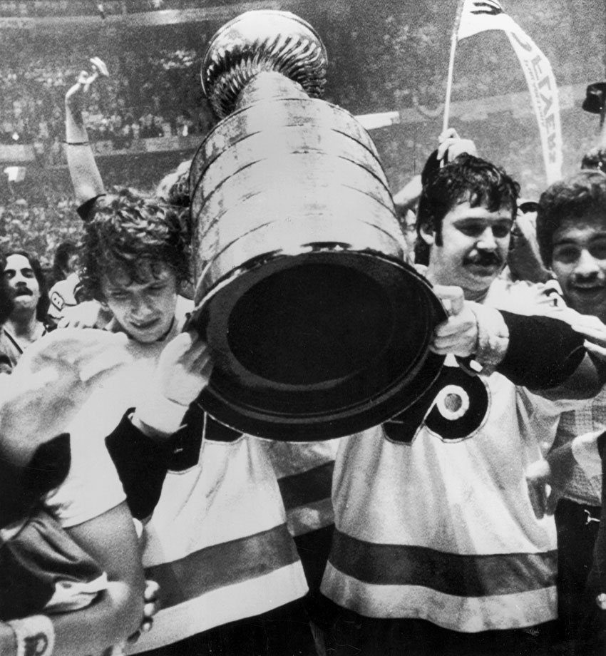 Flyers captain Bobby Clarke and Bernie Parent carry the the Stanley Cup after defeating the Bruins in Game 6 on May 19, 1974 in Philadelphia.