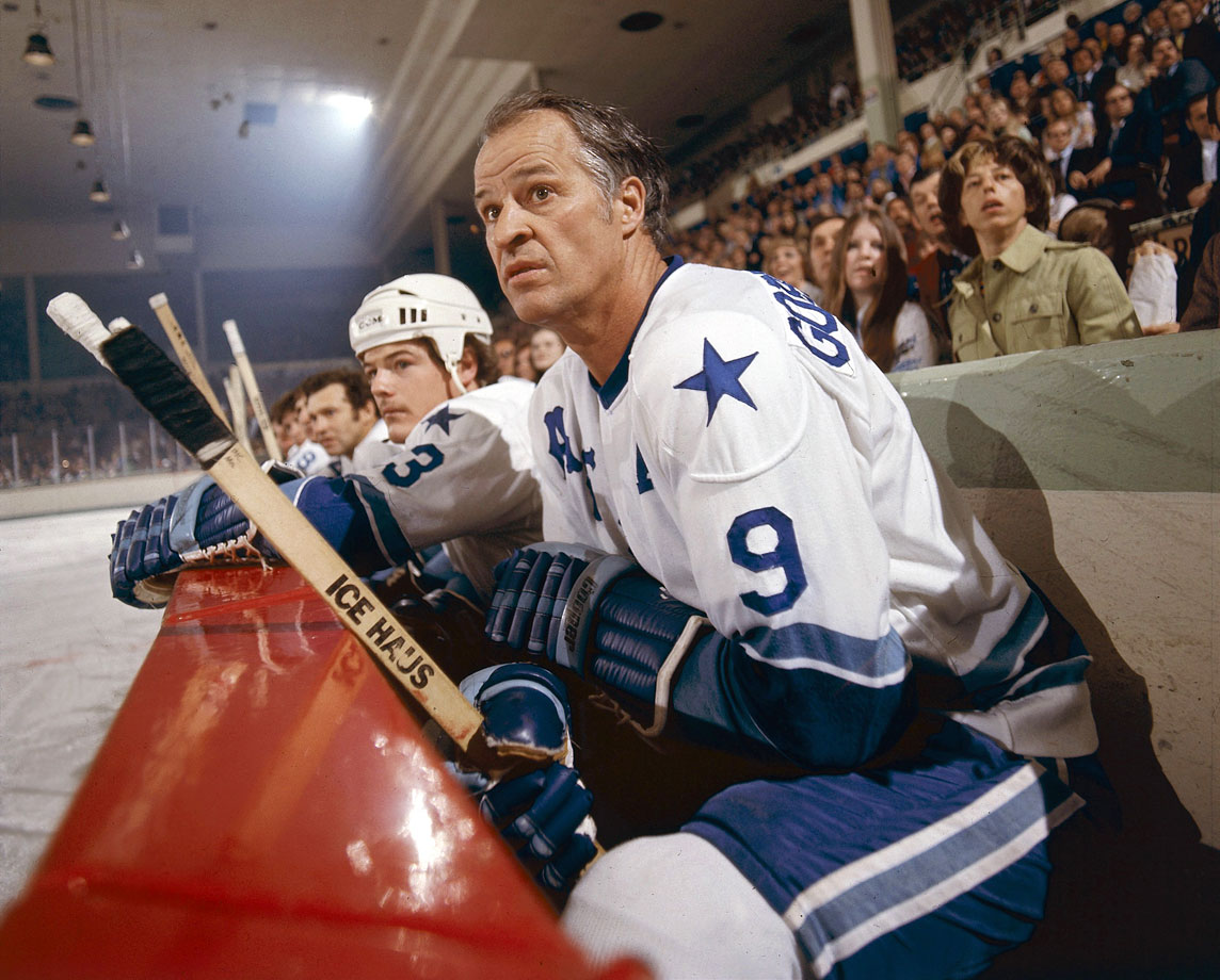 After coming out of his two-year retirement in 1973 to join the NHL's new rival -- the World Hockey Association -- Gordie Howe watches from the bench as his Houston Aeros play the Alberta Oilers. He won the first of his two Avco Cup championships with the Aeros that season, ultimately producing 37 points in 26 postseason games during the two title runs.