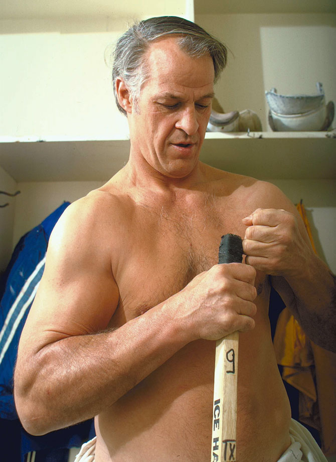 Gordie Howe tapes his stick before a game against the Vancouver Blazers. That season, he won the Gary L. Davidson Trophy as the WHA's Most Valuable Player. The award was renamed the Gordie Howe Trophy a year later.