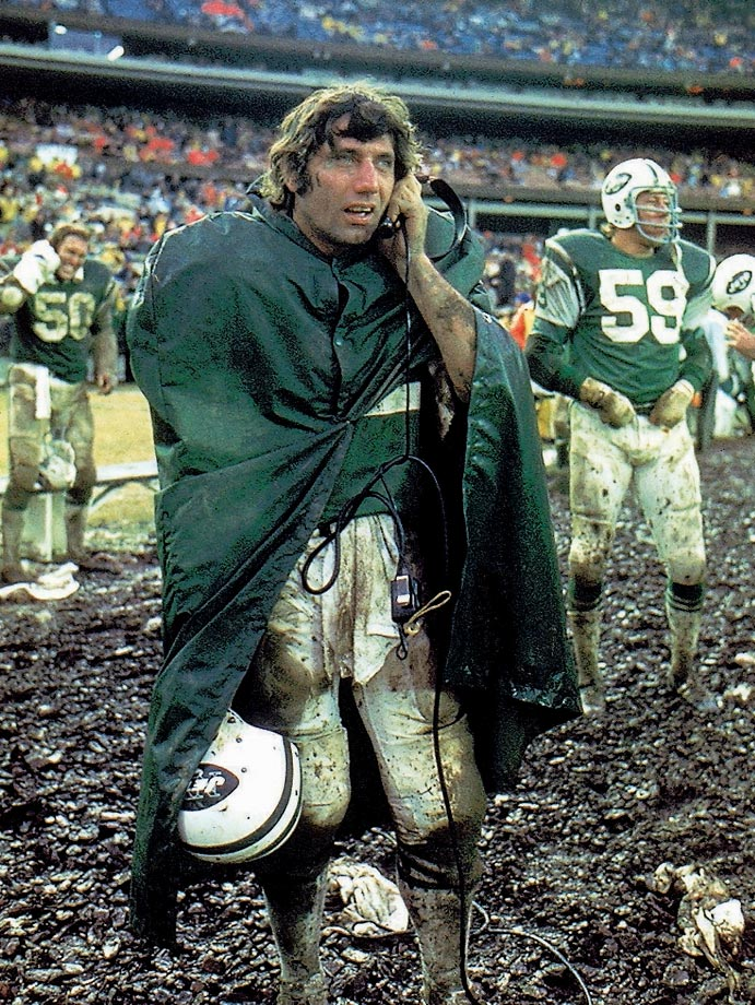 Jets quarterback Joe Namath listens on the sidelines during a messy game against the Bills at Shea Stadium.