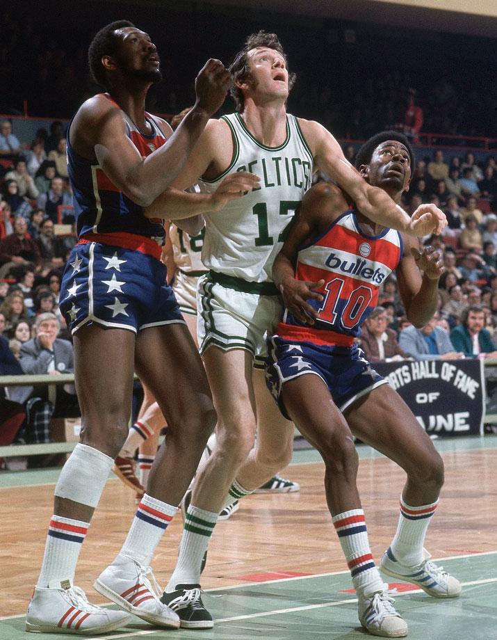 John Havlicek battles for position against Elvin Hayes and Kevin Porter during a Celtics game against the Capital Bullets at Boston Garden.