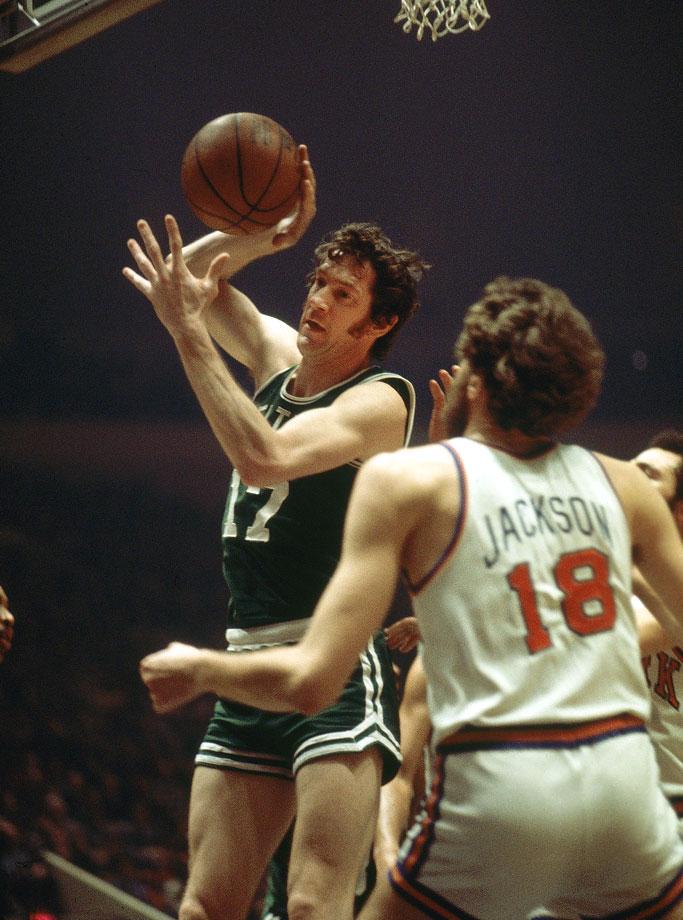 John Havlicek grabs a rebound over Phil Jackson during a Celtics game against the New York Knicks at Madison Square Garden.
