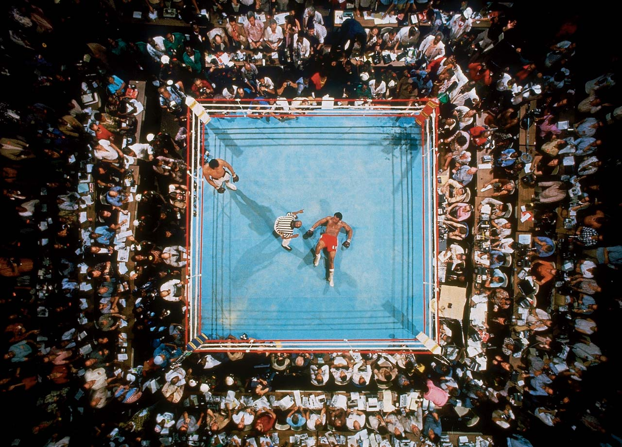 Big George stares at the ceiling as referee Zack Clayton counts him out in the eighth round. The victory made Ali, once again, the heavyweight champion of the world.