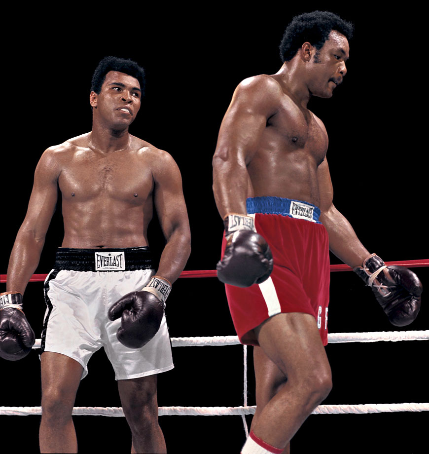 Ali stares at George Foreman during the Rumble in the Jungle. Ali earned his shot at the heavyweight title by defeating Joe Frazier in January 1974, avenging a loss three years earlier.