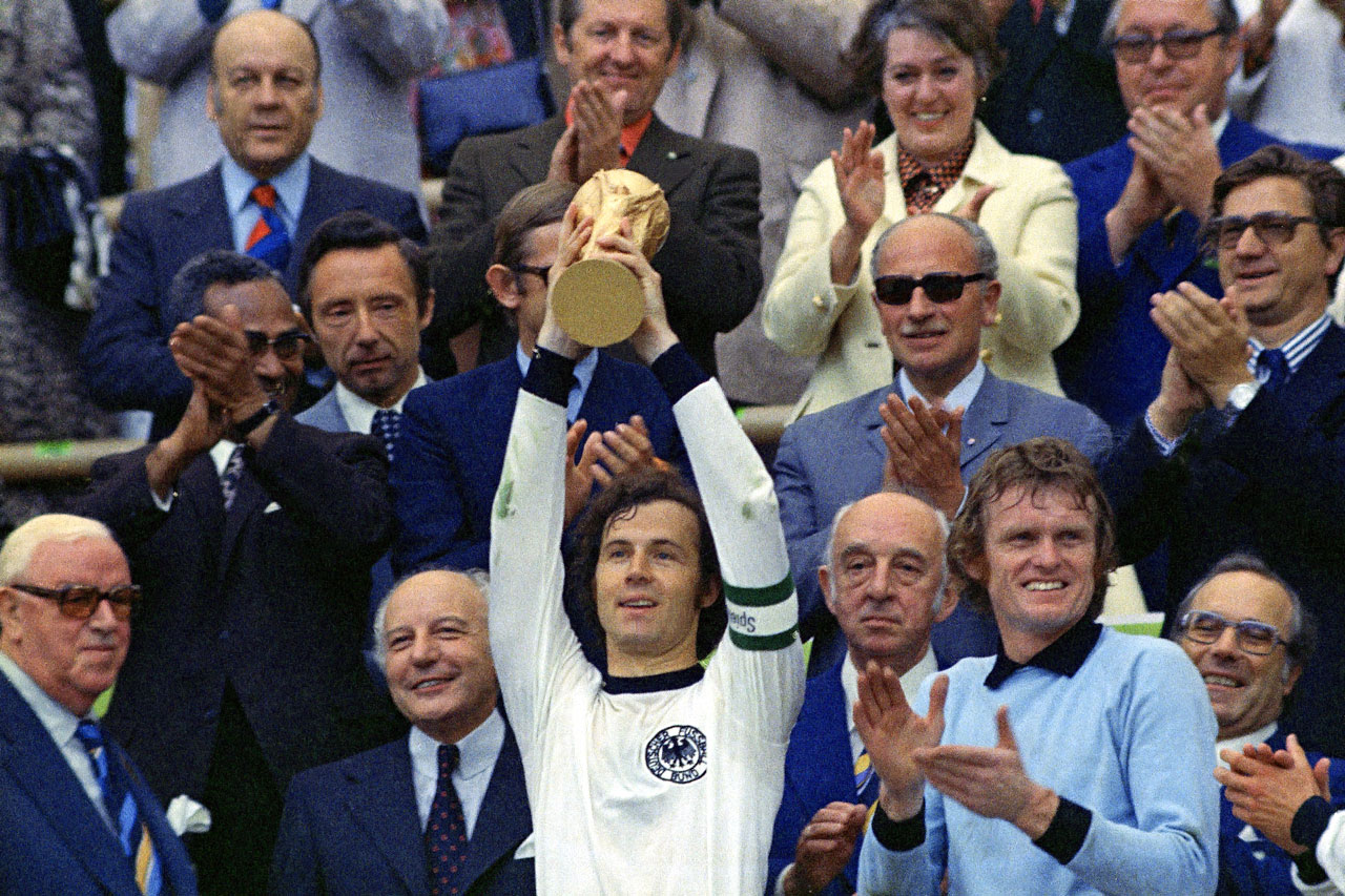 West German captain Franz Beckenbauer holds up the World Cup trophy after his team defeated the Netherlands, 2-1, in the 1974 World Cup final.