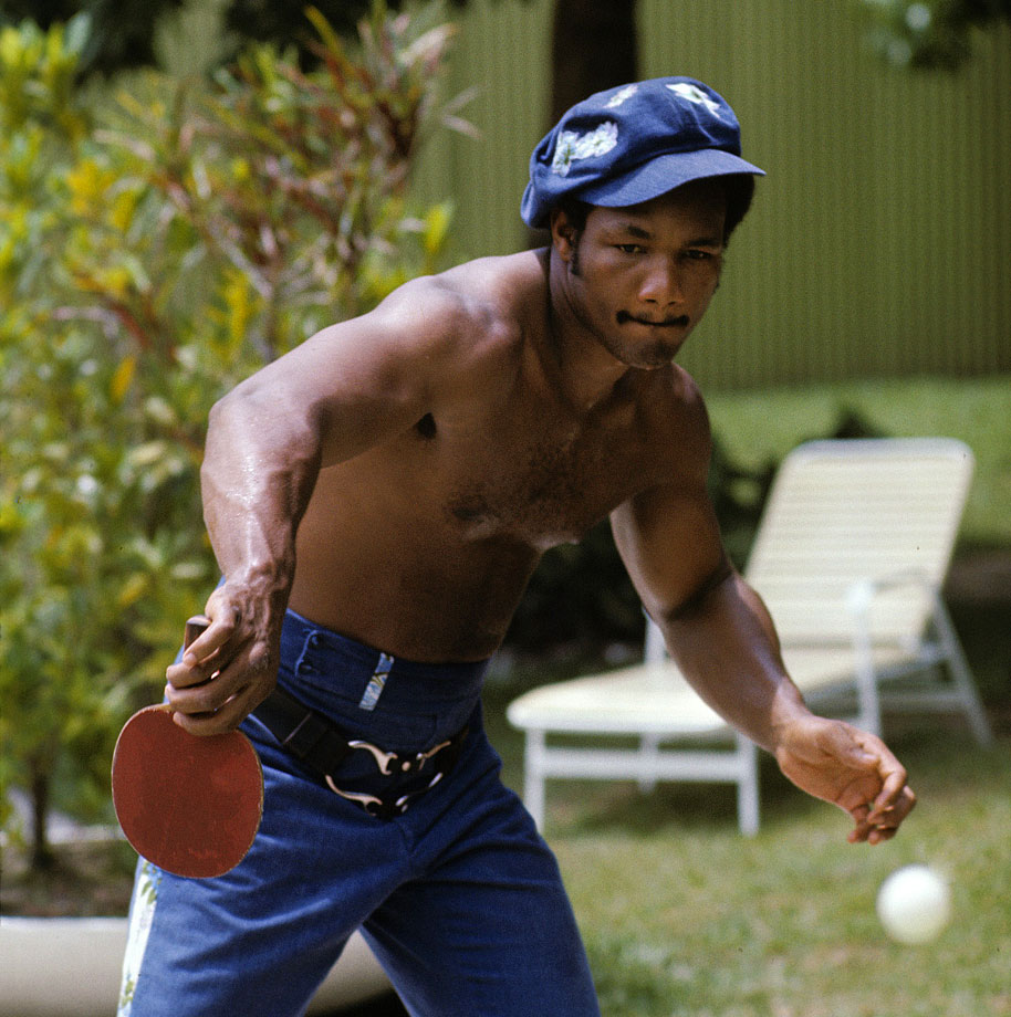 George Foreman plays ping pong in the days leading up to the fight.