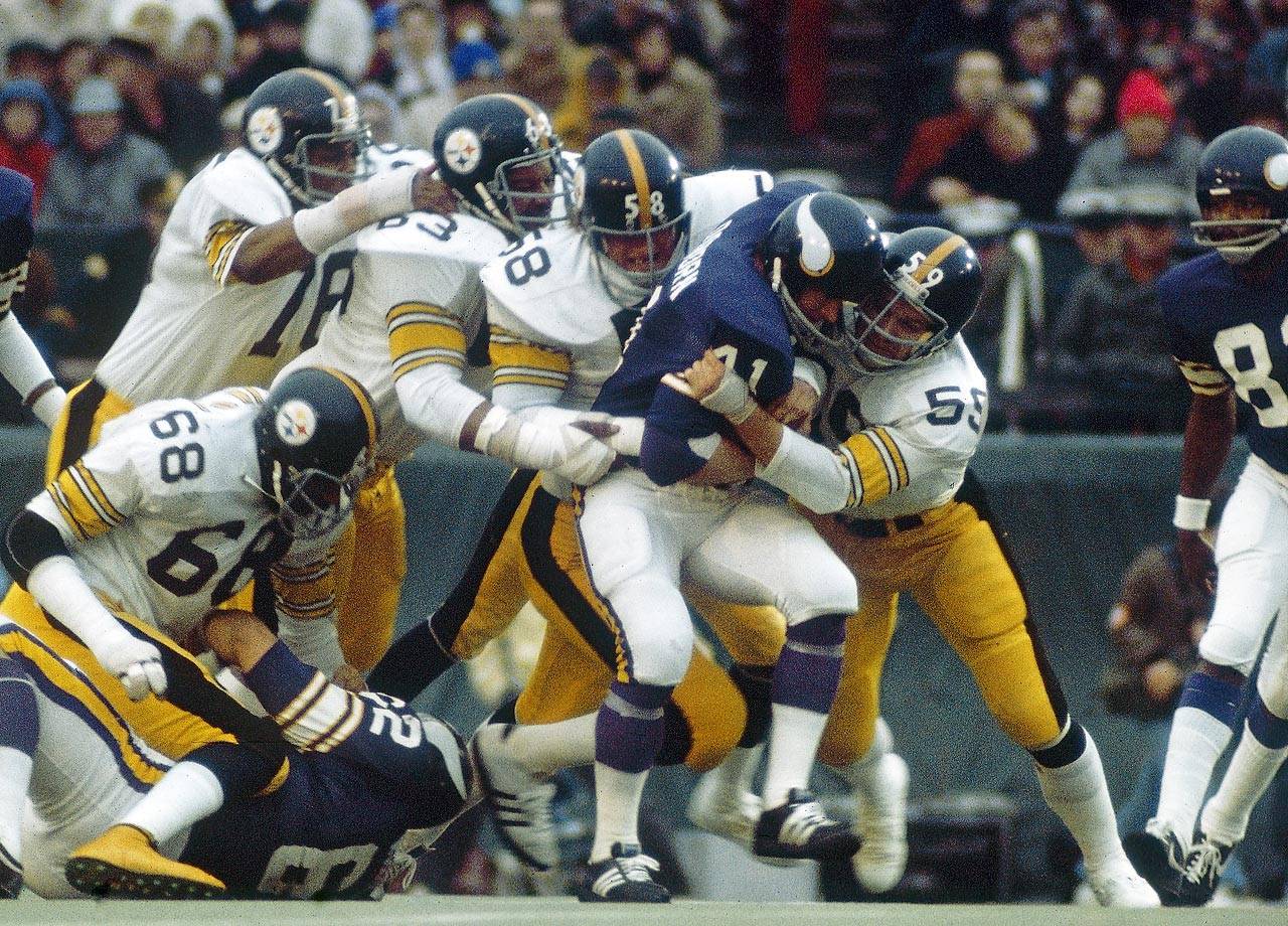 Jack Ham, Jack Lambert, Ernie Holmes and Dwight White of Pittsburgh's Steel Curtain defense swarm to Minnesota Vikings fullback Dave Osborn. Pittsburgh limited Minnesota to just 119 total offensive yards.