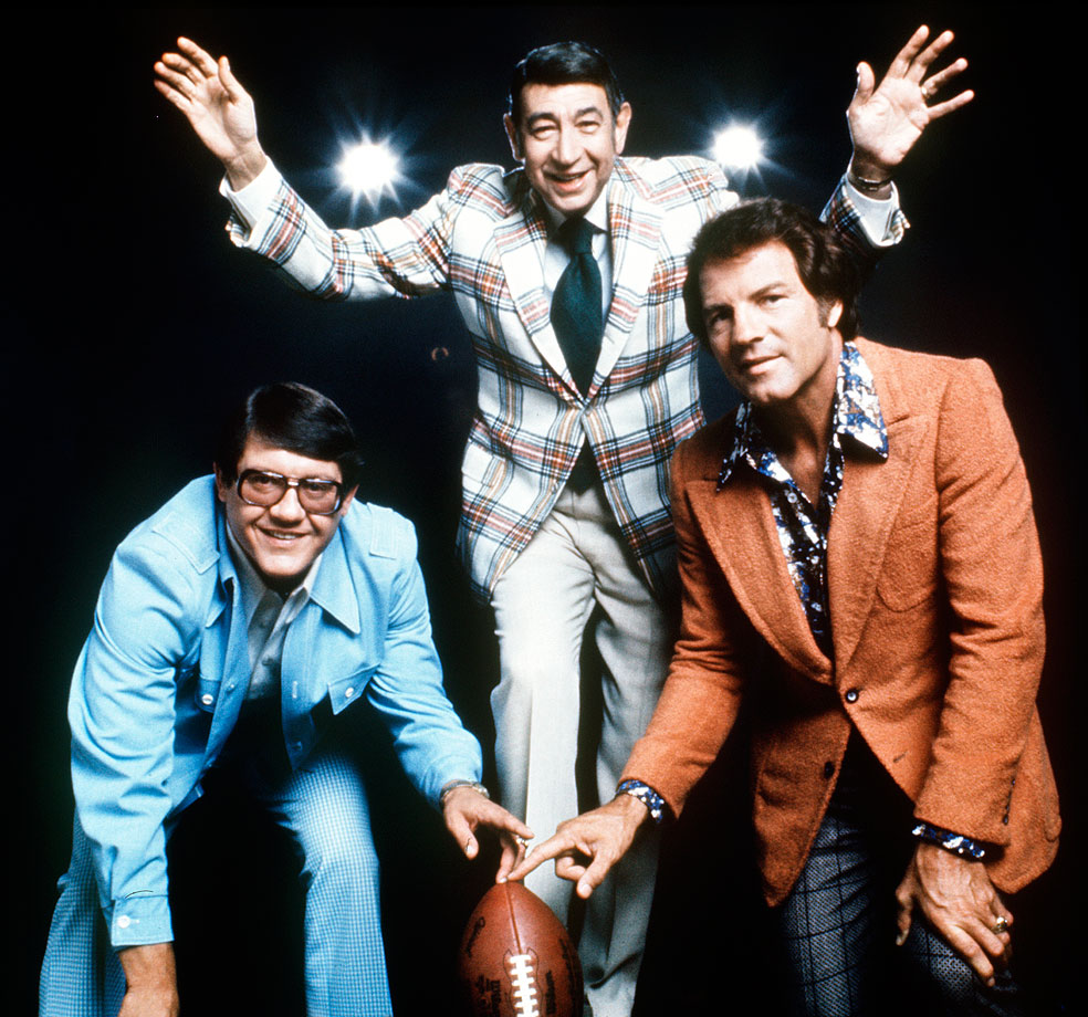 Alex Karras poses with Howard Cosell and Frank Gifford on June 24, 1975 to promote Monday Night Football.