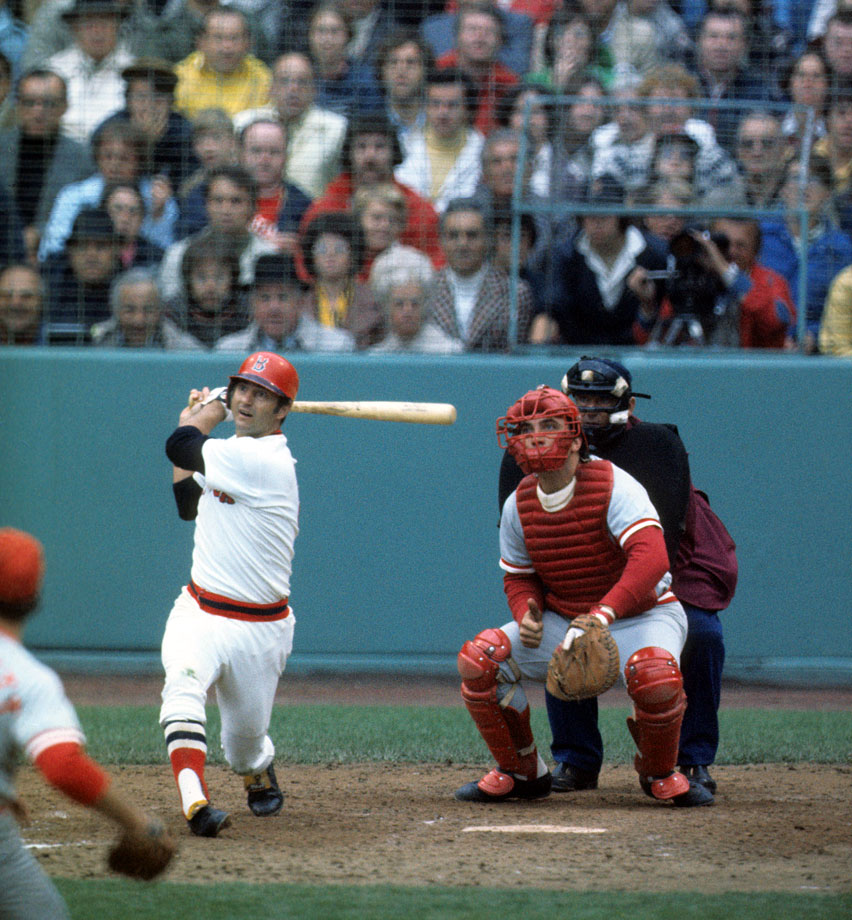 Carl Yastrzemski bats as Cincinnati Reds catcher Johnny Bench looks on during Game 1 of the World Series on Oct. 11, 1975 at Fenway Park in Boston.