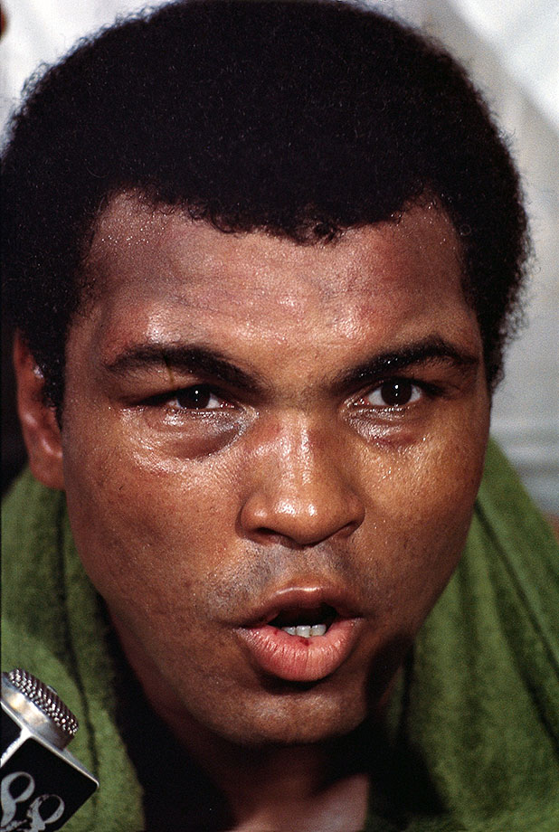 Ali speaks to the press after winning the Thrilla in Manila bout with Frazier.