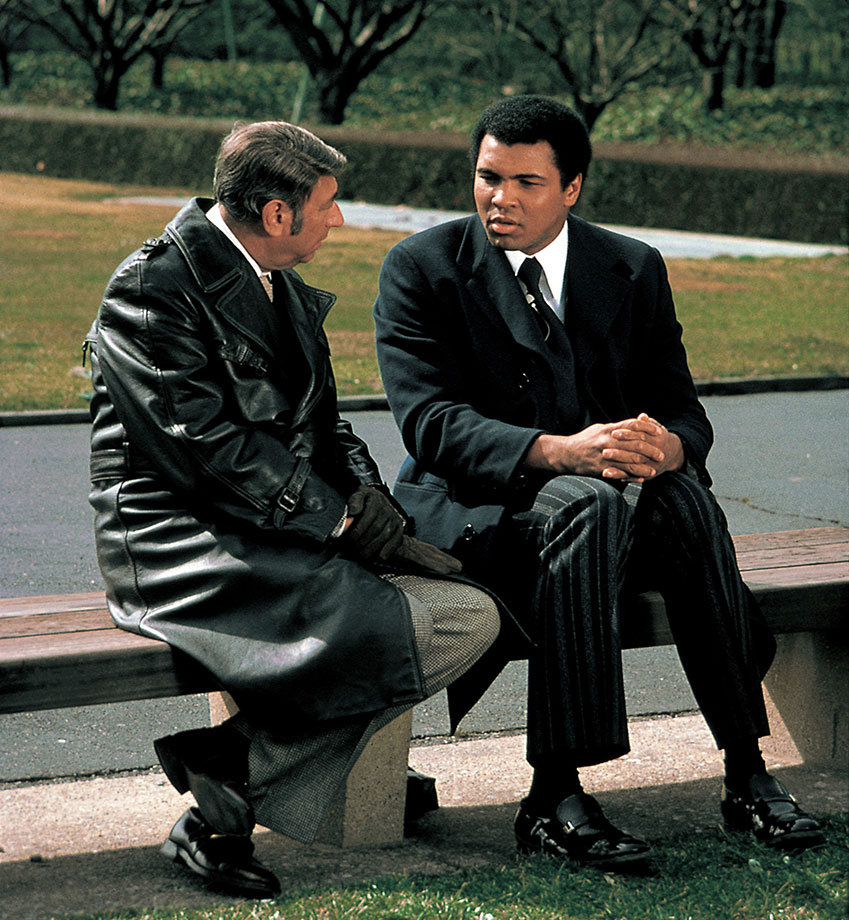 Ali talks with Howard Cosell outside of the United Nations Headquarters for a segment on the Wide World of Sports. Later that day, Ali held a press conference to announce that he would donate part of the proceeds from his fight against Chuck Wepner to help Africans in the Sahel drought.