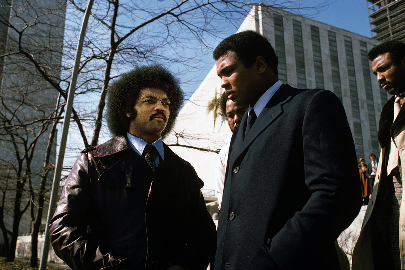 Ali talks with Reverend Jesse Jackson outside of the United Nations Headquarters before a press conference to announce that he would donate part of the proceeds from his fight against Chuck Wepner to help Africans in the Sahel drought.