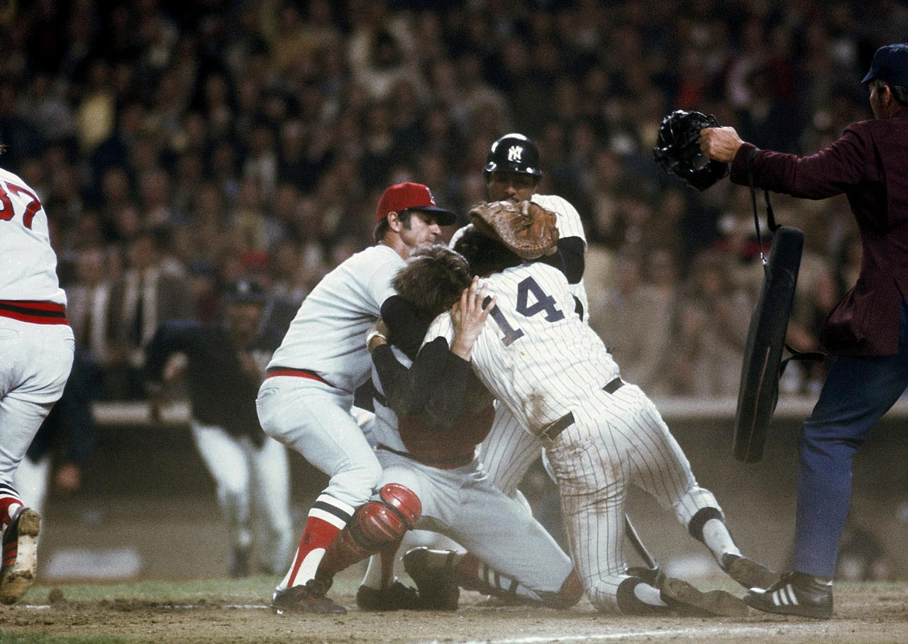Carl Yastrzemski tries to break up a fight between teammate Carlton Fisk and the New York Yankees' Lou Piniella on May 20, 1976 at Yankee Stadium in New York City. Piniella was out at home, but the collision started a bench-clearing brawl.