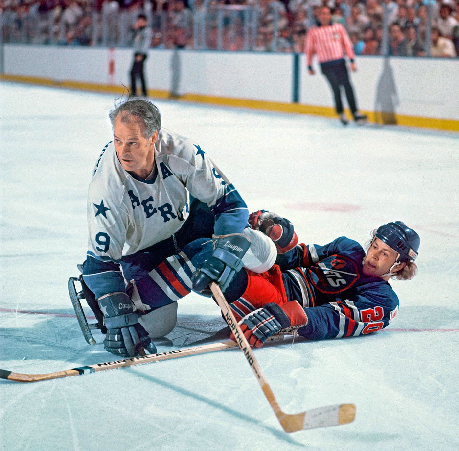 Gordie Howe follows the action after checking Willy Lindstrom during Game 1 of the WHA Avco World Trophy Finals between the Houston Aeros and Winnipeg Jets in Houston, Texas.