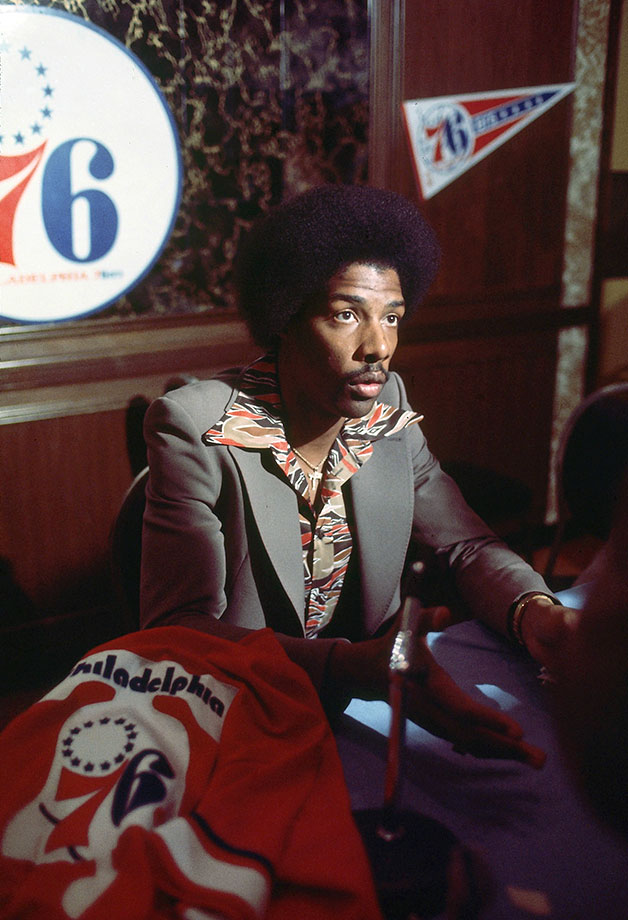 Dr. J sports a funky shirt at a press conference prior to his 76ers debut.