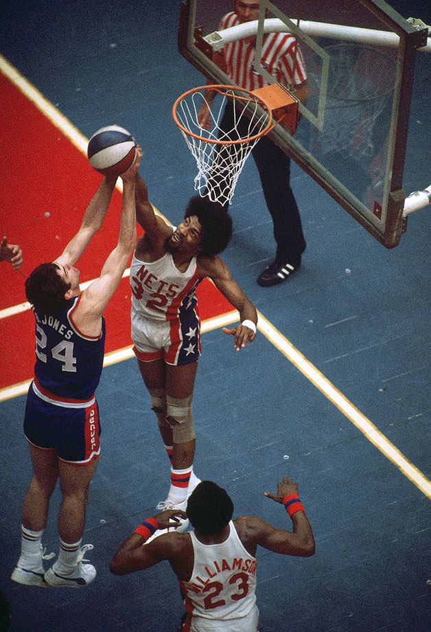Dr. J blocks a shot by Denver's Bobby Jones during an ABA Championship series in 1976.