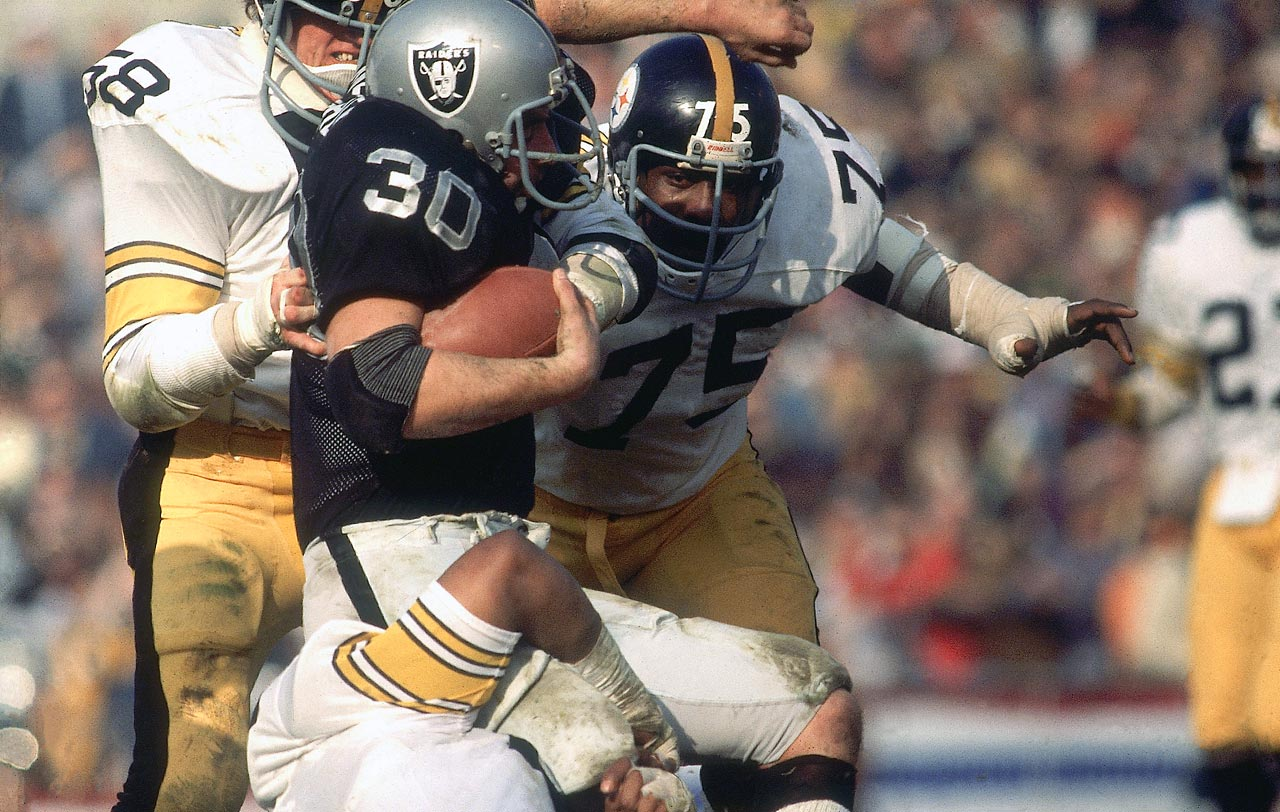 tackling Mark van Eeghen with Jack Lambert